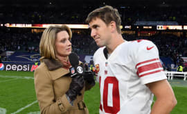Eli Manning talks with a reporter after the Giants-Rams game in London.