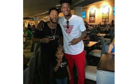 This is photo of Jimmy Butler and Derrick Rose.