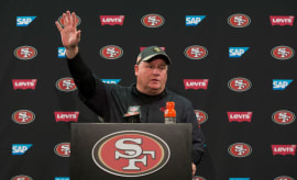 Chip Kelly waves goodbye to the press after his final press conference as the 49ers coach.