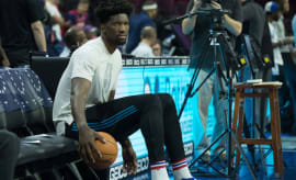 Joel Embiid sits on the bench.