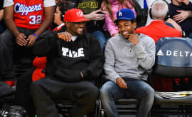 Anthony Tiffith (L) and Kendrick Lamar attend a basketball game