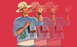 Pharrell in an ugly Christmas sweater.