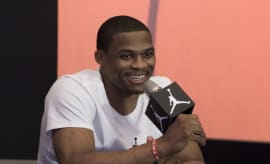 Russell Westbrook holding microphone