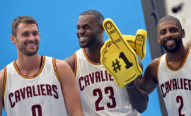 Kevin Love, Kyrie Irving, and LeBron James pose for photo together.
