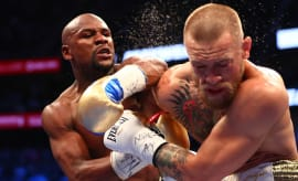 Mayweather lands a shot against Conor McGregor during their bout.