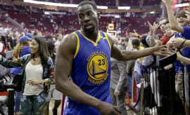Draymond Green walks off the court after a game against the Rockets.