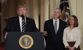 Judge Neil Gorsuch (C) and his wife Marie Louise look on