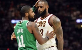 Kyrie Irving and LeBron James embrace on opening night.