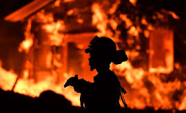 An inmate firefighter monitors flames