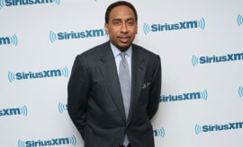 Stephen A. Smith poses on the red carpet.
