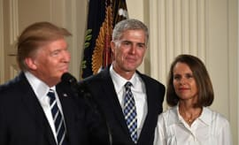 Judge Neil Gorsuch (C) and his wife  listen after Donald Trump nominated him for the Supreme Court