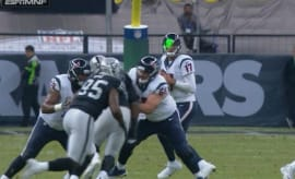 Fan shines laser pointer at Brock Osweiler.