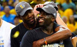 Draymond Green and Kevin Durant celebrate after the Warriors win the 2017 NBA title.