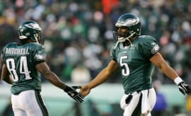 Freddie Mitchell and Donovan McNabb exchange a high-five after a play.