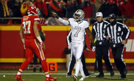 Marquette King and Travis Kelce exchange words on the field.