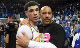 LaVar Ball hugs his son Lonzo.