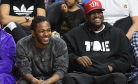 Anthony Tiffith and Kendrick Lamar at a Basketball Game