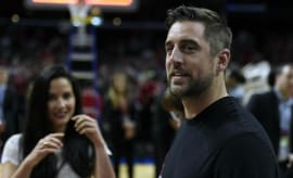 Aaron Rodgers and Olivia Munn at a basketball game.