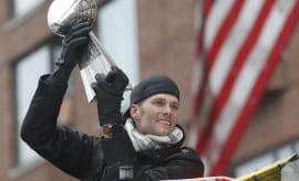 Tom Brady holds Super Bowl trophy at Patriots' championship parade.