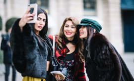 Soraya Shawsky, Maya Williams, and Thythu take a selfie, outside the Alexis Mabille show