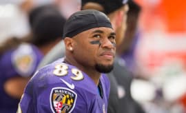 Steve Smith grimaces on the sideline.