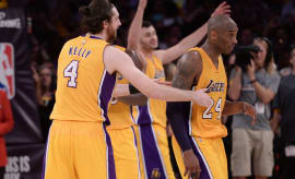 Kobe Bryant is celebrated by his teammates at the conclusion of his final game.