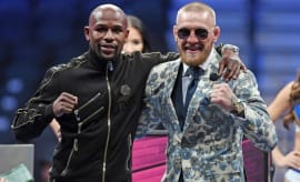 Floyd Mayweather and Conor McGregor pose after their big fight.