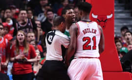 Jimmy Butler and Marcus Smart butt heads on the court.