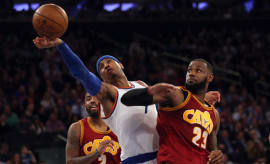 Carmelo Anthony fights for a loose ball against the Cavs.