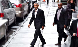 Barack Obama walking to his car in New York City.