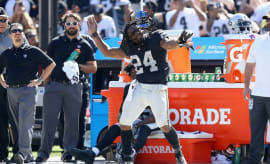 Marshawn Lynch dances on the sideline during a Raiders' win over the Jets.