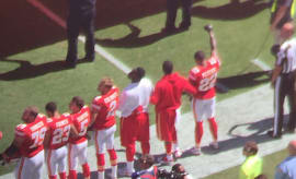 Kansas City Chiefs cornerback Marcus Peters raises his fist during the National Anthem.