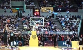 Stephen Curry gets blocked during an exhibition game in China.