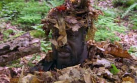 "Shaq dons a bunch of leaves while filming ""Running Wild"" with Bear Grylls."