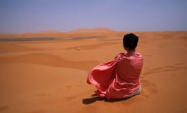 Woman meditating in the desert