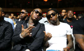 Lil Wayne's lawsuit against Universal has been put on hold until his dispute with Birdman is resolved.