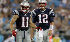 Julian Edelman and Tom Brady on the football field together