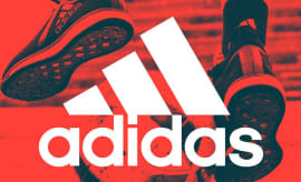 Adidas logo in front of sneakers