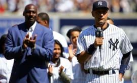 Michael Jordan claps for Derek Jeter.