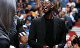 Kevin Garnett laughs on the bench.
