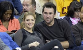 Kate Upton and Justin Verlander sitting courtside at a basketball game.