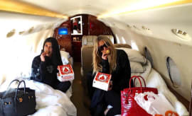 Kourtney and Khloe Kardashian Eating Popeyes