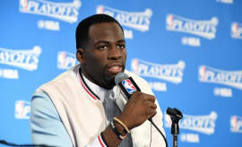 Draymond Green responds to a question at a press conference.