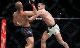 Conor McGregor fights Eddie Alvarez in their lightweight title bout during UFC 205.