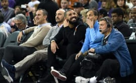 Drake sits courtside with Kings owner Vivek Ranadivé.