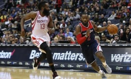 James Harden guards John Wall.