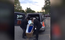 Teen arrives to prom in coffin