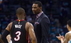 Chris Bosh talks to Dwyane Wade during a timeout against the Hornets in the 2016 playoffs.