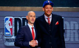 Isaiah Austin poses with Adam Silver at the 2014 NBA Draft.