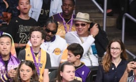 Snoop Dogg attends a Lakers game.
